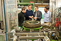 Wednesday 19 February 2014<br /> Pictured: Prime Minister David Cameron talks to factory worker  Tom Griffiths and Factory Director Neil Barnes <br /> Re: Prime Minister David Cameron visitingthe  St David Assemblies factory  in St. Davids, Pembrokeshire, Wales