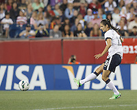 USWNT substitute midfielder Yael Averbuch (16) passes the ball. In an international friendly, the U.S. Women's National Team (USWNT) (white/blue) defeated Korea Republic (South Korea) (red/blue), 4-1, at Gillette Stadium on June 15, 2013.