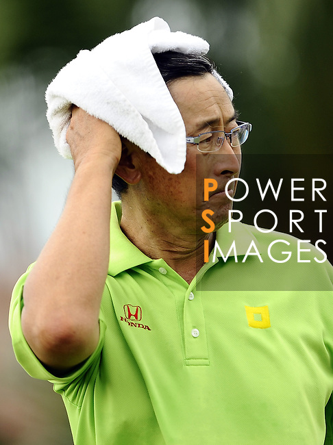TAIPEI, TAIWAN - NOVEMBER 19:  David Ishii of USA wipes his face on the 1st hole during day two of the Fubon Senior Open at Miramar Golf & Country Club on November 19, 2011 in Taipei, Taiwan. Photo by Victor Fraile / The Power of Sport Images