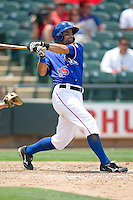 Second baseman Matt Kata #15 of the Round Rock Express swings against the Nashville Sounds in Pacific Coast League baseball on May 9, 2011 at the Dell Diamond in Round Rock, Texas. (Photo by Andrew Woolley / Four Seam Images)