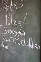 Close-up of school blackboard with chalk inscription at village school in Lubombo Region, Eswatini