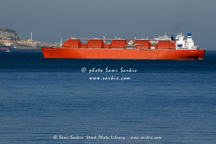 Container ship in the Strait of Gibraltar, Andalusia, Spain.