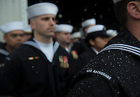 130504-N-DR144-500 ANCHORAGE, Alaska (May 4, 2013)-  Snow falls on crew members as they wait to bring the ship to life during the commissioning ceremony of San Antonio-class amphibious transport dock ship USS Anchorage (LPD 23) at the Port of Anchorage. More than 4,000 people gathered to witness the ship's commissioning in its namesake city of Anchorage, Alaska. Anchorage, the seventh San Antonio-class LPD, is the second ship to be named for the city and the first U.S. Navy ship to be commissioned in Alaska. (U.S. Navy photo by Mass Communication Specialist 1st Class James R. Evans / RELEASED)