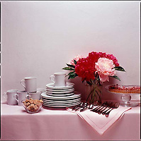 Side board with china, silverware, flowers & pastry<br />
