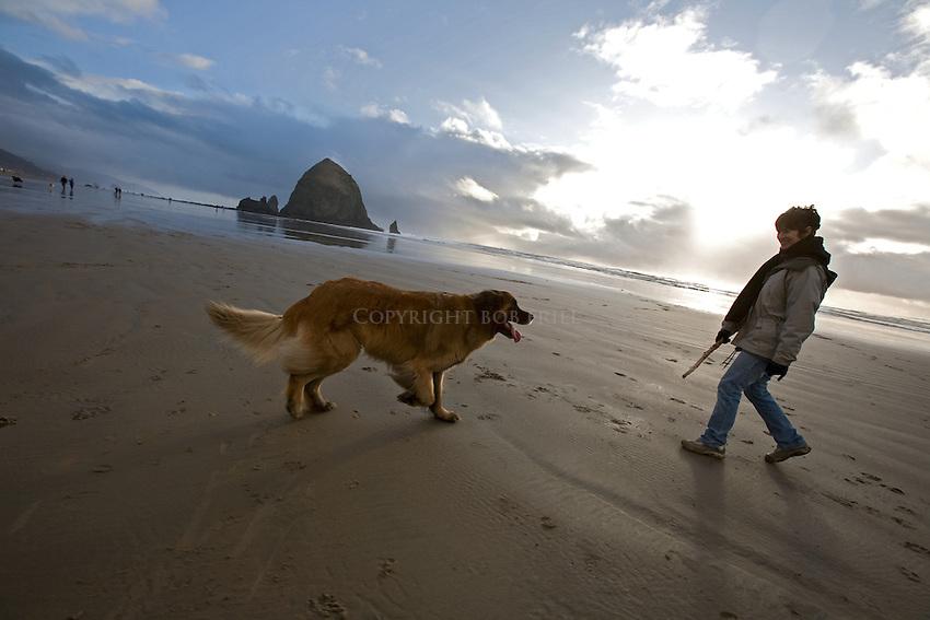 Scenes of Leonberger dog enjoying Cannon Beach, Oregon