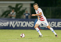 GEORGETOWN, GRAND CAYMAN, CAYMAN ISLANDS - NOVEMBER 19: Aaron Long #3 of the United States moves with the ball during a game between Cuba and USMNT at Truman Bodden Sports Complex on November 19, 2019 in Georgetown, Grand Cayman.