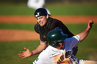 St. Bonaventure Bonnies catcher Tommy LaCongo (11) swipes the tag at Hayden Rappoport (20) sliding into home during a game against the Dartmouth Big Green on February 25, 2017 at North Charlotte Regional Park in Port Charlotte, Florida.  St. Bonaventure defeated Dartmouth 8-7.  (Mike Janes/Four Seam Images)
