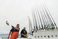 "150620-JRE-7981E-1210 The crew of Seward Fishing Club's ""Rainisong"" process fish after a successful trip for salmon and rockfish"
