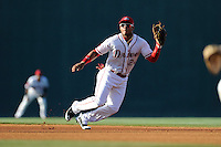 Second baseman Yoan Moncada of the Greenville Drive plays a ground ball in a game against the Rome Braves on Monday, June 15, 2015, at Fluor Field at the West End in Greenville, South Carolina. The Cuban-born 19-year-old Red Sox signee has been ranked the No. 1 international prospect in baseball by Baseball America. (Tom Priddy/Four Seam Images)