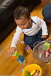 12 month old toddler baby boy stacking blocks