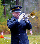 Sargeant Chris Walker, with the 133rd Army National Guard Band, blows Taps during a Veteran's Day service in Gardiner, Washington.