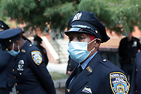 NEW YORK, NEW YORK: SEPTEMBER 25, 2020- New York City Police officer at 308 West 128 Street, Manhattan, in recognition of National Day of Remembrance for Murder Victims in the Harlem section of New York City on September 25, 2020.   <br /> CAP/MPI43<br /> ©MPI43/Capital Pictures