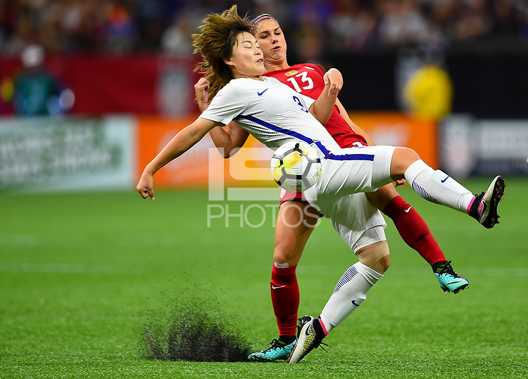New Orleans, LA - Thursday October 19, 2017: Alex Morgan, Shin Damyeong during an International friendly match between the Women's National teams of the United States (USA) and South Korea (KOR) at Mercedes Benz Superdome.
