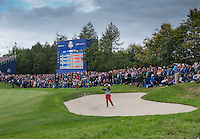 28.09.2014. Gleneagles, Auchterarder, Perthshire, Scotland. The Ryder Cup, final day.  Phil Mickelson [USA] chips from the bunker on the 11th green during Sunday Singles.