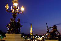 Paris, Ile de France, France, Europe, Ponte de la Concorde and Eiffel Tower along the Seine River in the city of Paris in the evening.