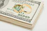 Wedding ring son bunch of dollar banknotes, studio shot