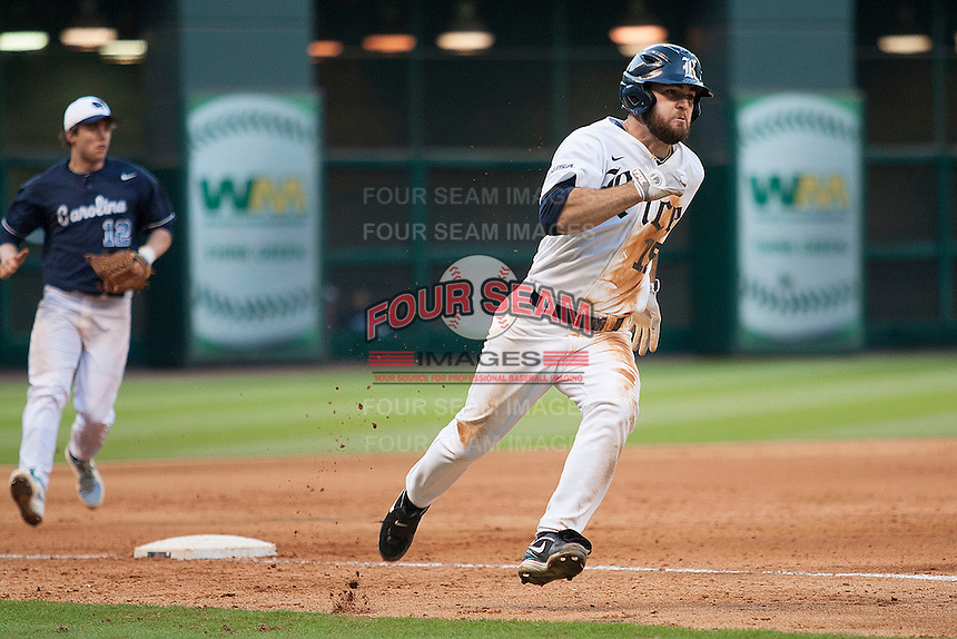 Rice Owls designated hitter Michael Aquino #15 rounds third base headed home during the NCAA baseball game against the North Carolina Tar Heels on March 1st, 2013 at Minute Maid Park in Houston, Texas. North Carolina defeated Rice 2-1. (Andrew Woolley/Four Seam Images).