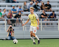 HARTFORD, CT - AUGUST 17: Erik McCue #4 of Charleston Battery looks to pass during a game between Charleston Battery and Hartford Athletic at Dillon Stadium on August 17, 2021 in Hartford, Connecticut.