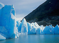 The giant ICE WALL of GREY GLACIER as it enters GREY LAKE in TORRES DEL PAINE NATIONAL PARK - PATAGONIA, CHILE