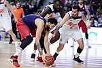 Real Madrid's Othello Hunter and Rudy Fernandez and FC Barcelona Lassa's Victor Faverani during Liga Endesa match between Real Madrid and FC Barcelona Lassa at Wizink Center in Madrid, Spain. March 12, 2017. (ALTERPHOTOS/BorjaB.Hojas)