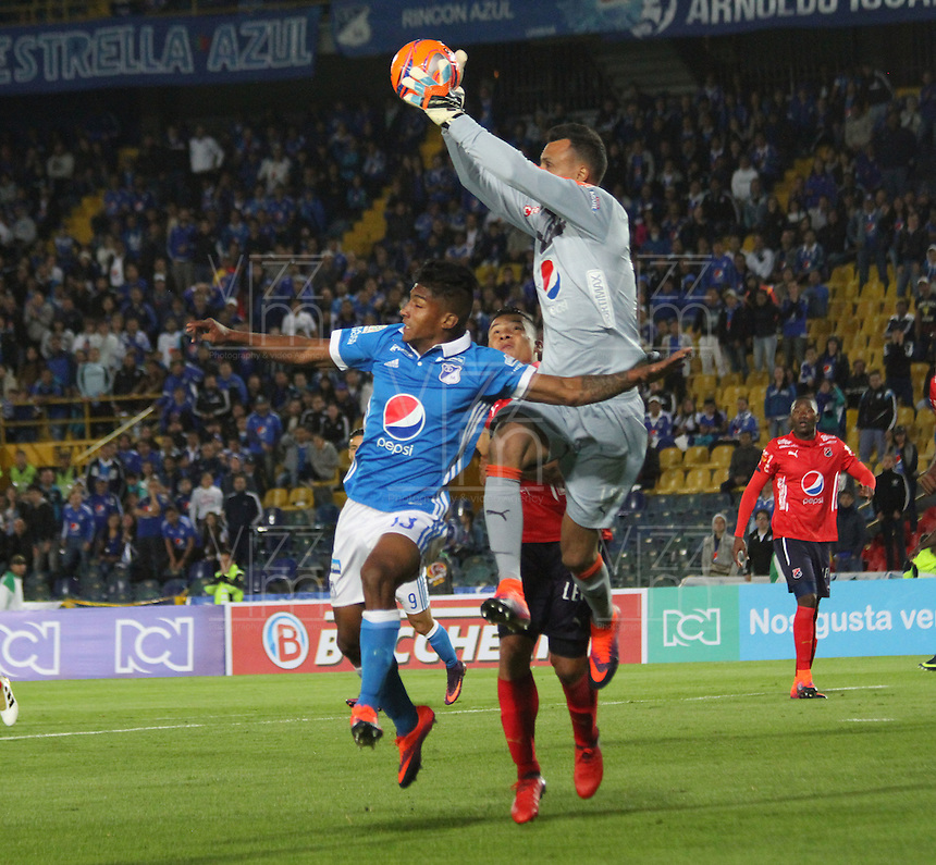 BOGOTA -COLOMBIA, 5-02-2017. Harold Mosquera (L) player of Millonarios  fights for the ball with David Gonzalez (R) player of Independiente Medellin  during match for the date 1 of the Aguila League I 2017 played at Nemesio Camacho El Campin stadium . Photo:VizzorImage / Felipe Caicedo  / Staff