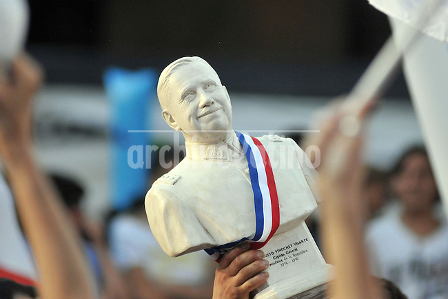 A supporter of chile elect president sebastian Pinera holds a figure of former dictator Augusto Pinoche during the celebration  in the runoff presidential elections in Santiago, Sunday, Jan. 17, 2010. Billionaire Sebastian Pinera, of the opposition center-right Coalition for Change, won the election ending two decades of center-left rul