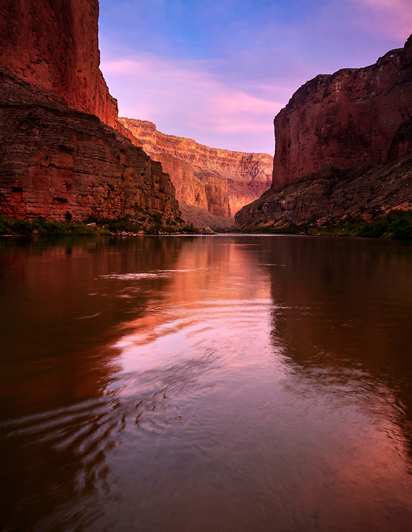 The cliffs along the Colorado River as viewed from Saddle Canyon Camp glow at sunset in the Grand Canyon National Park, AZ
