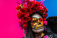 A young Mexican woman, dressed as La Catrina, a Mexican pop culture icon representing the Death, takes part in the Day of the Dead celebrations in Oaxaca, Mexico, 31 October 2019. Day of the Dead (Día de Muertos), a religious holiday combining the death veneration rituals of Pre-Hispanic cultures with the Catholic practice, is widely celebrated throughout all of Mexico. Based on the belief that the souls of the departed may come back to this world on that day, people gather together while either praying or joyfully eating, drinking, and playing music, to remember friends or family members who have died and to support their souls on the spiritual journey.