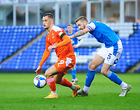 Blackpool's Jerry Yates shields the ball from Peterborough United's Mark Beevers<br /> <br /> Photographer Chris Vaughan/CameraSport<br /> <br /> The EFL Sky Bet League One - Peterborough United v Blackpool - Saturday 21st November 2020 - London Road Stadium - Peterborough<br /> <br /> World Copyright © 2020 CameraSport. All rights reserved. 43 Linden Ave. Countesthorpe. Leicester. England. LE8 5PG - Tel: +44 (0) 116 277 4147 - admin@camerasport.com - www.camerasport.com