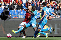 Calcio, Serie A: Roma vs Napoli. Roma, stadio Olimpico, 25 aprile 2016.<br /> Roma's Radja Nainggolan, left, is challenged by Napoli's Kalidou Koulibaly, center, and Raul Albiol during the Italian Serie A football match between Roma and Napoli at Rome's Olympic stadium, 25 April 2016.<br /> UPDATE IMAGES PRESS/Riccardo De Luca