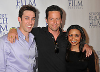 """PAUL J. ALESSI, producer/actor, ROSS McCALL & DANIELLE NICOLET.""""Knuckle Draggers"""" Premiere at the 2009 Newport Beach Film Festival held at Edwards Cinemas, Newport Beach, CA, USA..April 27th, 2009.half length black top purple shirt arms over shoulders.CAP/ADM/BP.©Byron Purvis/AdMedia/Capital Pictures."""