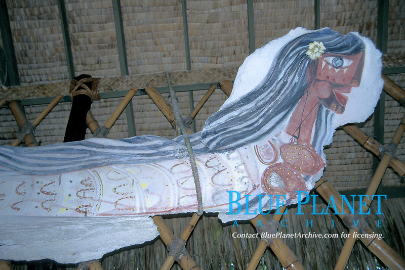Polynesian mermaid, native art painted on jaw bone of whale, Rangiroa, Tahiti, French Polynesia