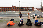 December 22, 2014. Lexington, North Carolina.<br />  Frank Callicutt looks on as other members of his workout group do leg lifts on the platform of an old railroad depot.<br />   Newell Clark, the 43 year old mayor of Lexington, NC, leads a group of friends and colleagues on a 4 times a week exercise routine around downtown. The group uses existing infrastructure, such as an abandoned furniture factory, loading docks, stairs, and handrails to get fit and increase awareness of healthy lifestyles in a town more known for BBQ.<br /> Jeremy M. Lange for the Wall Street Journal<br /> Workout_Clark