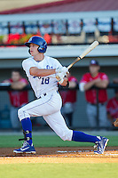 Logan Moon (18) of the Burlington Royals follows through on his swing against the Danville Braves at Burlington Athletic Park on July 5, 2014 in Burlington, North Carolina.  The Royals defeated the Braves 5-4.  (Brian Westerholt/Four Seam Images)