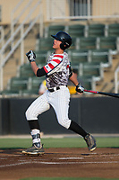 Blake Rutherford (20) of the Kannapolis Intimidators follows through on his swing against the West Virginia Power at Kannapolis Intimidators Stadium on July 21, 2017 in Kannapolis, North Carolina.  (Brian Westerholt/Four Seam Images)