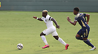 CARY, NC - AUGUST 01: Anderson Asiedu #6 runs the ball up the field while being chased by Dre Fortune #8 during a game between Birmingham Legion FC and North Carolina FC at Sahlen's Stadium at WakeMed Soccer Park on August 01, 2020 in Cary, North Carolina.