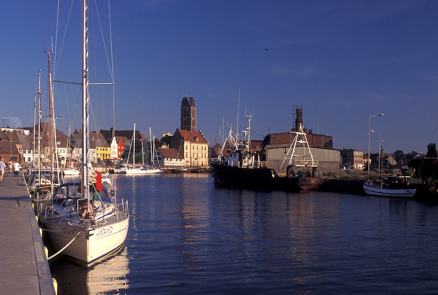 Germany, Wismar, Europe, Mecklenburg-Pomerania, Baltic Sea, Boats docked in the harbor along the Baltic Sea in Wismar.