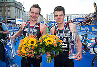 12 JUL 2014 - HAMBURG, GER - Winner of the elite men's 2014 ITU World Triathlon Series round in Hamburg, Germany, Alistair Brownlee (GBR) (left) from Great Britain walks from the medal ceremony with his brother and team mate, Jonathan Brownlee (GBR) who took third place (PHOTO COPYRIGHT © 2014 NIGEL FARROW, ALL RIGHTS RESERVED)