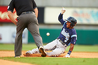 Corpus Christi Hooks second baseman Tony Kemp (7) slides into second on a double during a game against the Arkansas Travelers on May 29, 2015 at Dickey-Stephens Park in Little Rock, Arkansas.  Corpus Christi defeated Arkansas 4-0 in a rain shortened game.  (Mike Janes/Four Seam Images)
