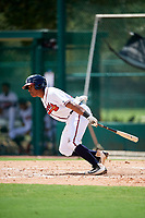 GCL Braves second baseman Braulio Vasquez (20) follows through on a swing during the first game of a doubleheader against the GCL Yankees West on July 30, 2018 at Champion Stadium in Kissimmee, Florida.  GCL Yankees West defeated GCL Braves 7-5.  (Mike Janes/Four Seam Images)