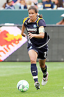 Shannon Boxx #7 of the Los Angeles Sol attacks the defense of the Washington Freedom during their inaugural match at Home Depot Center on March 29, 2009 in Carson, California.