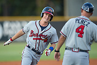 Drew Waters (12) of the Danville Braves is all smiles as he rounds the bases after hitting a 3-run home run against the Burlington Royals at Burlington Athletic Stadium on August 14, 2017 in Burlington, North Carolina.  The Royals defeated the Braves 9-8 in 10 innings.  (Brian Westerholt/Four Seam Images)