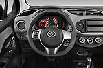 Car pictures of steering wheel view of a 2015 Toyota Yaris Le 5 Door Hatchback