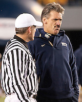 Pitt head coach Dave Wannstedt (right) talks to an official. The West Virginia Mountaineers defeated the Pittsburgh  Panthers 19-16 on November27, 2009 at Mountaineer Field at Milan Puskar Stadium, Morgantown, West Virginia.