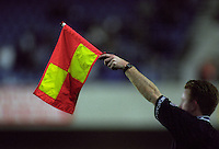Football referee holding up his flag