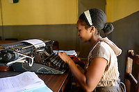 MADAGASCAR, Mananjary, court, clerk typing on typewriter / MADAGASKAR, Mananjary, Amtsgericht, Angestellte schreibt auf einer Schreibmaschine im Gerichtssaal