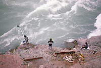 Native American Indians fishing for Salmon in Chilcotin River, Cariboo Chilcotin Coast Region, BC,  British Columbia, Canada
