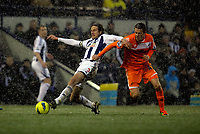 Pictured: Gylfi Sigurdsson of Swansea (R) challenging Jonas Olsson of West Bromwich (L). Saturday, 04 February 2012<br /> Re: Premier League football, West Bromwich Albion v Swansea City FC v at the Hawthorns Stadium, Birmingham, West Midlands.