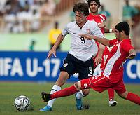 Jack McInerney tries to avoid the tackle. US Under-17 Men's National Team defeated United Arab Emirates 1-0 at Gateway International  Stadium in Ijebu-Ode, Nigeria on November 1, 2009.