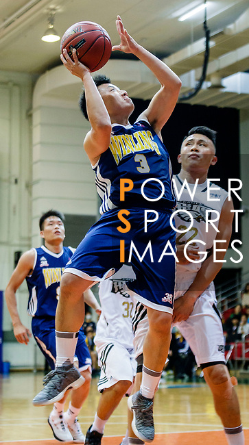 Liang Man Hung #3 of Winling Basketball Club tries to score next to Ling Kwan Lung #22 of Eagle Basketball Team during the Hong Kong Basketball League game between Eagle and Winling at Southorn Stadium on May 4, 2018 in Hong Kong. Photo by Yu Chun Christopher Wong / Power Sport Images
